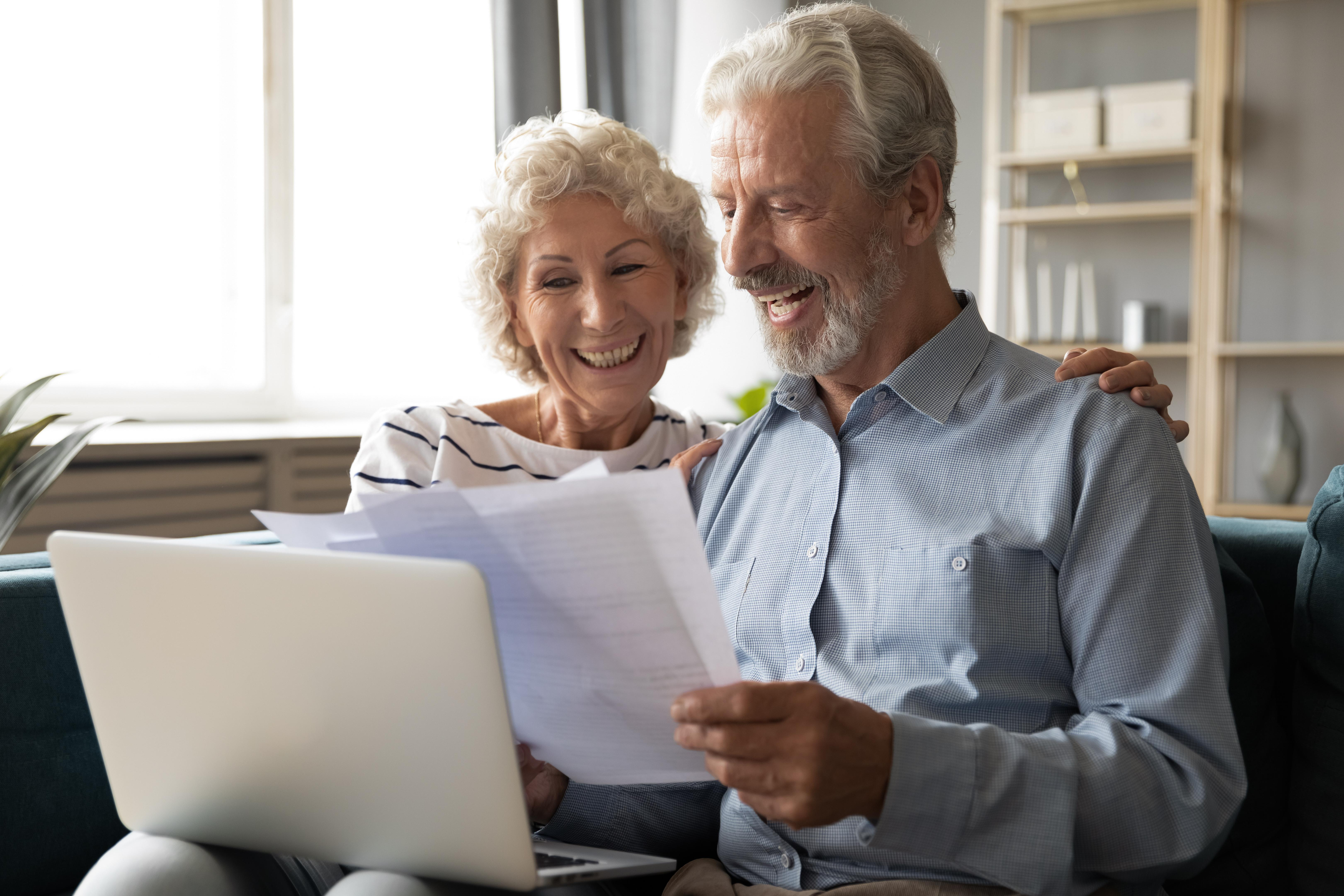older couple getting results of home energy assessment online