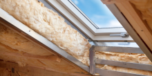 skylight window in attic roof showing insulation, before finishing touches