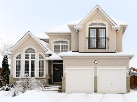two story house covered in snow