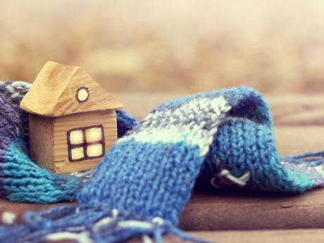 model house wrapped in a scarf, warm home concept